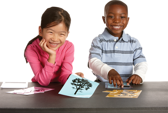 Two children using FOSS Science materials