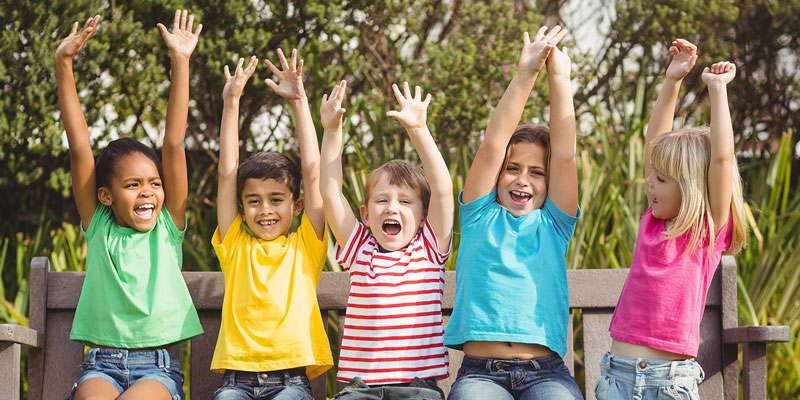 Group of children cheering outdoors