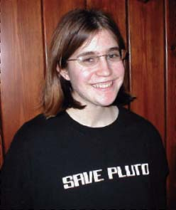 Person with Save Pluto shirt