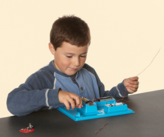 Student working with a circuit board experiment