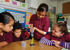 Students working with a cylinder